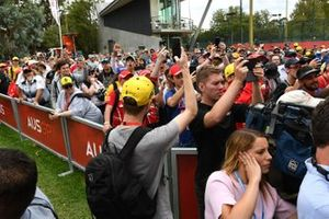 Fans outside the paddock