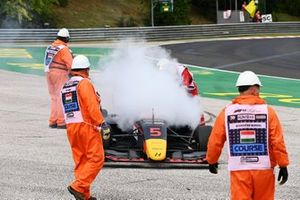 Liam Lawson, Hitech Grand Prix retires with a smoking car and is attended to by marshals