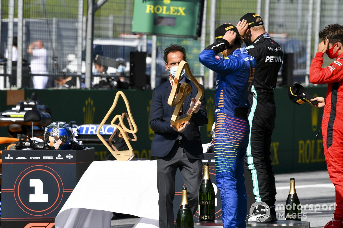 Lando Norris, McLaren receives the 3rd place trophy on the podium