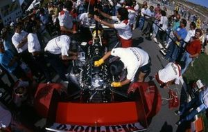 Mechanics work on the Honda RA168-E engine of Ayrton Senna, McLaren MP4/4