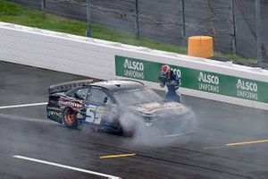 Garrett Smithley, Rick Ware Racing Chevrolet exits the vehicle following an on-track incident