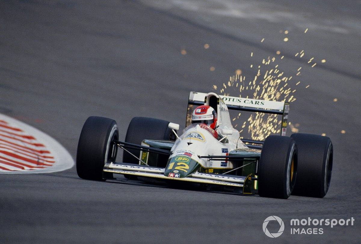 Sparks fly from the underside of Johnny Herbert's Lotus 102B Judd