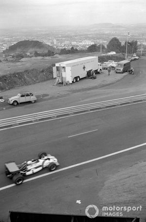 George Eaton, BRM P153 passes the medical van