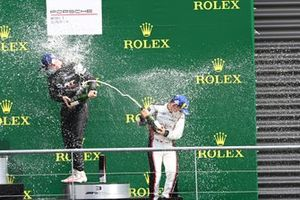 Ayhancan Guven, martinet by Almeras, 1st position, and Florian Latorre, CLRT, 3rd position, celebrate with Champagne on the podium