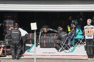 The Mercedes pit crew with tyres in warmers