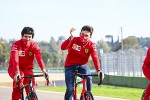 Charles Leclerc, Ferrari, cycles around the circuit with team mates