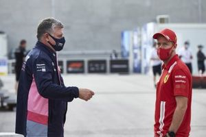 Otmar Szafnauer, Team Principal and CEO, Racing Point and Sebastian Vettel, Ferrari in the paddock