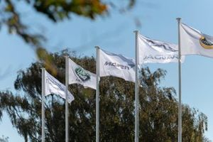 Flags showing Lotus, Jaguar, McLaren and Land Rover brand logos