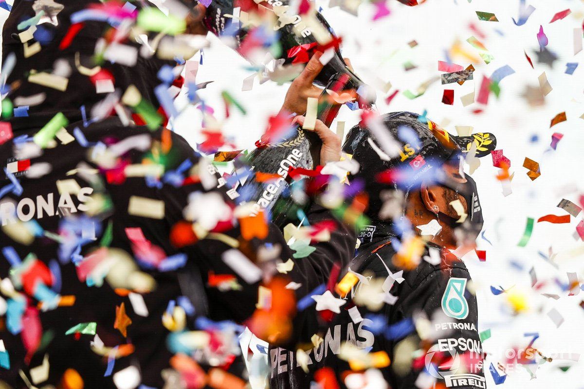 Lewis Hamilton, Mercedes-AMG F1, celebrates on the podium after winning the race, to take his 7th World Championship titl