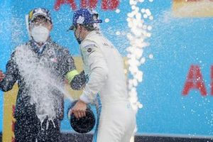 Nyck de Vries, Mercedes-Benz EQ, 1st position, sprays Albert Lau, Race Engineer, Mercedes Benz EQ, with Champagne on the podium