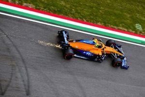 Sparks trail behind Lando Norris, McLaren MCL35M