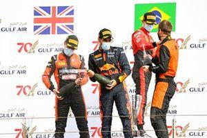 Race Winner Felipe Drugovich, MP Motorsport, Jehan Daruvala, Carlin and Callum Ilott, UNI-Virtuosi celebrate on the podium with the champagne
