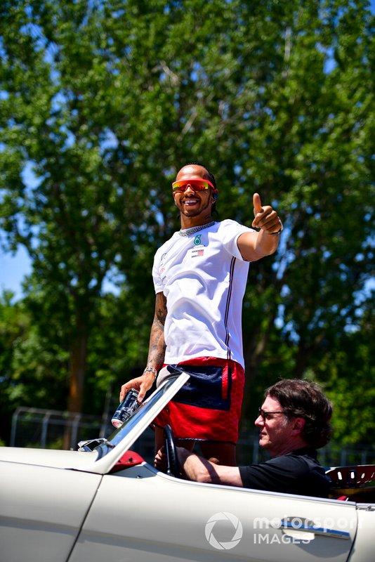Lewis Hamilton, Mercedes AMG F1, waves to the crowd during the drivers parade