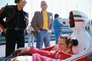 Niki Lauda, Ferrari 312T, with Huschke von Hanstein and Austrian journalist Heinz Prueller
