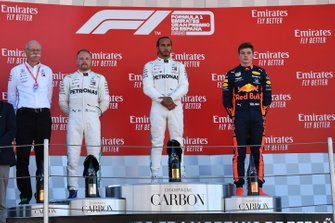 Dr Dieter Zetsche, CEO, Mercedes Benz Valtteri Bottas, Mercedes AMG F1, 2nd position, Lewis Hamilton, Mercedes AMG F1, 1st position, and Max Verstappen, Red Bull Racing, 3rd position, on the podium