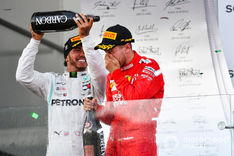 Lewis Hamilton, Mercedes AMG F1, 2nd position, pours Champagne over Sebastian Vettel, Ferrari, 3rd position, on the podium