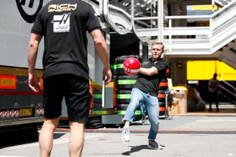 Kevin Magnussen, Haas F1, plays football with a team mate
