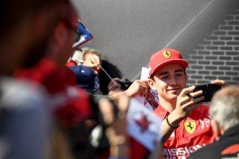 Charles Leclerc, Ferrari poses for a selfie with a fan