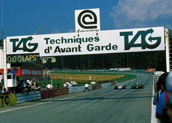Elio de Angelis, Lotus Cosworth 91 and Keke Rosberg, Williams Cosworth FW08 accelerate for the finish line side by side
