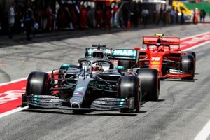 Lewis Hamilton, Mercedes AMG F1 W10, leads Charles Leclerc, Ferrari SF90, out of the pits