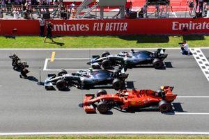 Top three Qualifiers Valtteri Bottas, Mercedes AMG W10, Lewis Hamilton, Mercedes AMG F1 W10, and Sebastian Vettel, Ferrari SF90, park on the grid after Qualifying