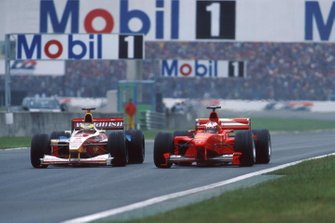 Ralf Schumacher, Williams FW21; Michael Schumacher, Ferrari F399