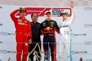 Charles Leclerc, Ferrari, Toyoharu Tanabe, F1 Technical Director, Honda, Race Winner Max Verstappen, Red Bull Racing and Valtteri Bottas, Mercedes AMG F1 celebrate on the podium