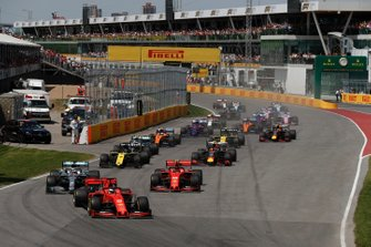 Sebastian Vettel, Ferrari SF90, leads Lewis Hamilton, Mercedes AMG F1 W10, Charles Leclerc, Ferrari SF90, Daniel Ricciardo, Renault F1 Team R.S.19, Pierre Gasly, Red Bull Racing RB15, and the rest of the filed at the start