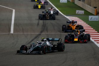 Valtteri Bottas, Mercedes AMG W10, leads Max Verstappen, Red Bull Racing RB15, and Carlos Sainz Jr., McLaren MCL34