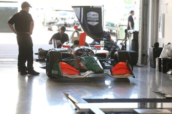Juncos Racing crew works in their garage