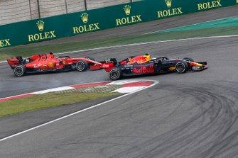 Sebastian Vettel, Ferrari SF90 and Max Verstappen, Red Bull Racing RB15 battle