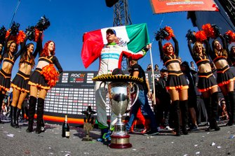 Winner Benito Guerra, celebrates on the podium