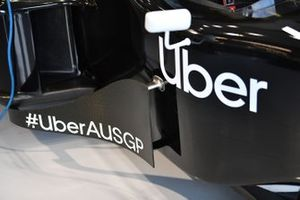 Two-seater side-pod and cockpit detail, including Uber branding