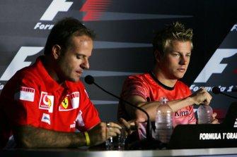 Rubens Barrichello, Ferrari and Kimi Raikkonen, McLaren