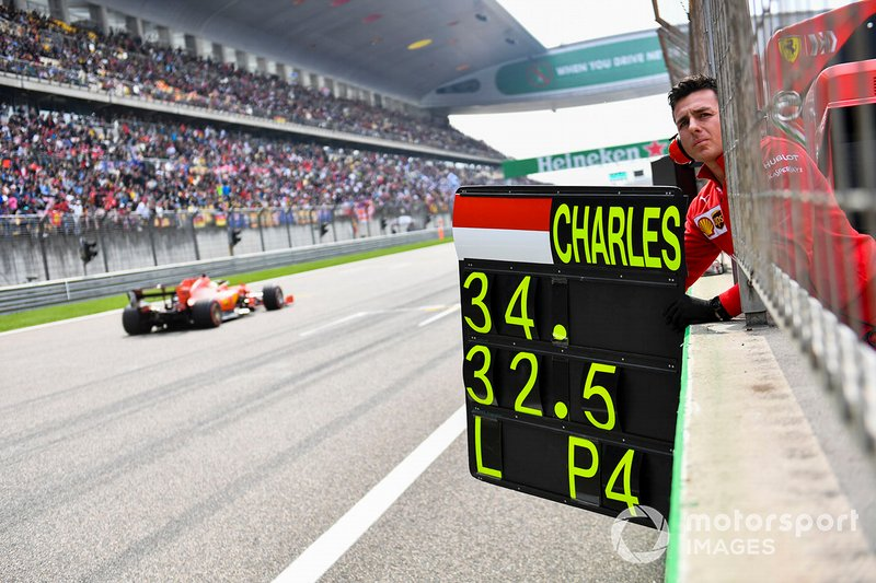 The Ferrari pit board is deployed as Sebastian Vettel, Ferrari SF90, passes