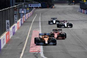 Daniel Ricciardo, McLaren MCL35M, Carlos Sainz Jr., Ferrari SF21, Kimi Raikkonen, Alfa Romeo Racing C41, and Nicholas Latifi, Williams FW43B