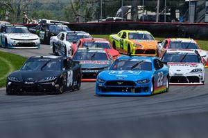 Ty Gibbs, Joe Gibbs Racing, Toyota Supra Joe Gibbs Racing and Austin Cindric, Team Penske, Ford Mustang PPG