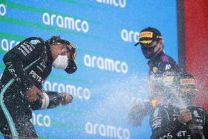 Lewis Hamilton, Mercedes1st sprays Valtteri Bottas, Mercedes, 3rd position, and Max Verstappen, Red Bull Racing, 2nd position, with Champagne