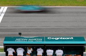 Lance Stroll, Aston Martin AMR21, passes the Aston Martin pit wall