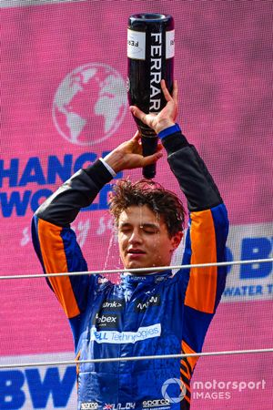Lando Norris, McLaren, 3rd position, pours Champagne over his head on the podium