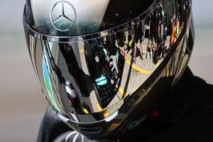 Car of Lewis Hamilton, Mercedes W12 in a helmet of a mechanic
