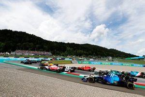 Nicholas Latifi, Williams FW43B, Sebastian Vettel, Aston Martin AMR21, and Esteban Ocon, Alpine A521, chase the pack at the start