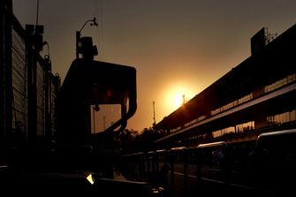 The sun sets behind the pit buildings