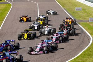 Pierre Gasly, Scuderia Toro Rosso STR13, leads Brendon Hartley, Toro Rosso STR13, Sergio Perez, Racing Point Force India VJM11, Esteban Ocon, Racing Point Force India VJM11, Carlos Sainz Jr., Renault Sport F1 Team R.S. 18, Charles Leclerc, Sauber C37, and the remainder of the field at the start of the race
