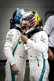 Valtteri Bottas, Mercedes AMG F1, congratulates team mate Lewis Hamilton, Mercedes AMG F1, on securing pole