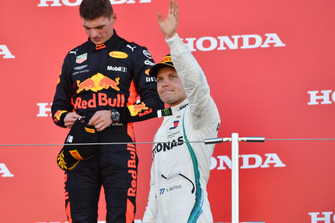 Valtteri Bottas, Mercedes AMG F1 and Max Verstappen, Red Bull Racing celebrate on the podium