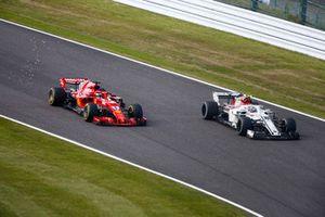 Sebastian Vettel, Ferrari SF71H, passes Charles Leclerc, Sauber C37