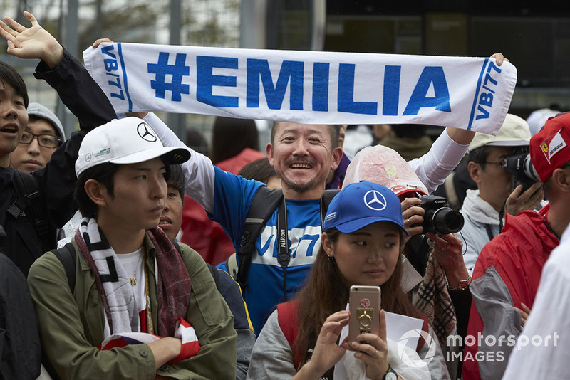 A fan with a banner with Valtteri Bottas' wife Emilia's name