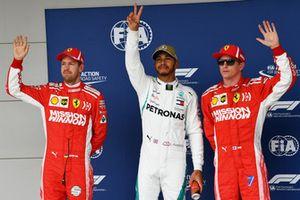 Polesitter Lewis Hamilton, Mercedes AMG F1, second place Sebastian Vettel, Ferrari, third place Kimi Raikkonen, Ferrari,