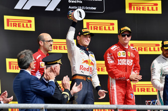 (L to R): Carlo Santi, Ferrari Race Engineer, Max Verstappen, Red Bull Racing with the trophy and Kimi Raikkonen, Ferrari